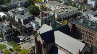 AX142_240 - 6K stock footage aerial video approaching, flying by Gate of Heaven Catholic Church, South Boston, Massachusetts