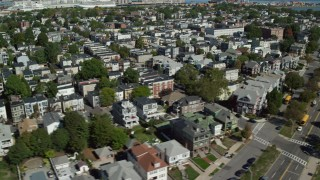 AX142_244 - 6K stock footage aerial video flying by a coastal community, reveal beach, South Boston, Massachusetts