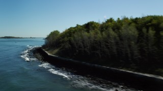 AX142_251 - 6K stock footage aerial video flying low by Long Island, Boston Harbor, Massachusetts