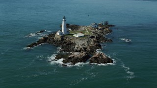 AX142_259 - 6K stock footage aerial video orbiting the Boston Light, Little Brewster Island, Boston Harbor, Massachusetts