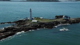 AX142_260 - 6K stock footage aerial video orbiting Boston Light, Little Brewster Island, Boston Harbor, Massachusetts