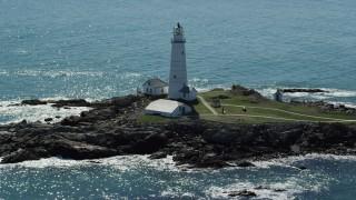 AX142_261 - 6K stock footage aerial video orbiting Boston Light, Little Brewster Island, Boston Harbor, Massachusetts