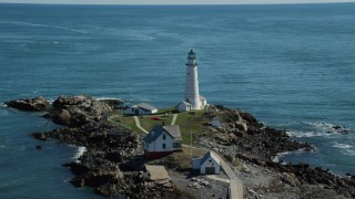 AX142_262 - 6K stock footage aerial video orbiting Boston Light, Boston Harbor, Little Brewster Island, Massachusetts