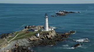 AX142_263 - 6K stock footage aerial video orbiting the Boston Light, Little Brewster Island, Boston Harbor, Massachusetts