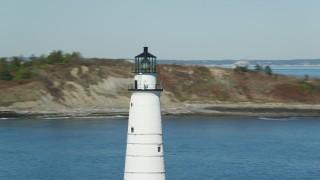 AX142_264 - 6K stock footage aerial video orbiting top of Boston Light, Little Brewster Island, Boston Harbor, Massachusetts