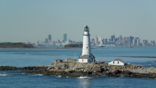 AX142_265 - 6K stock footage aerial video orbiting Boston Light, Little Brewster Island, Boston Harbor, Massachusetts