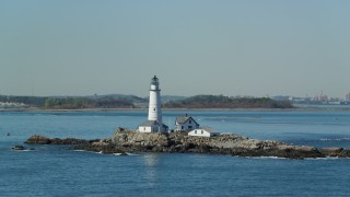 AX142_266 - 6K stock footage aerial video flying by the Boston Light, Little Brewster Island, Boston Harbor, Massachusetts