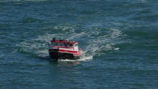 AX142_271 - 6K stock footage aerial video tracking a lobster fishing boat, Boston Harbor, Massachusetts