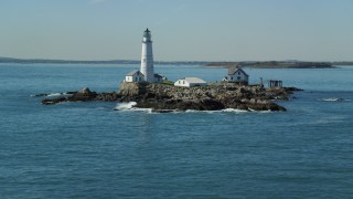 AX142_275 - 6K stock footage aerial video approaching Boston Light, Little Brewster Island, Boston Harbor, Massachusetts
