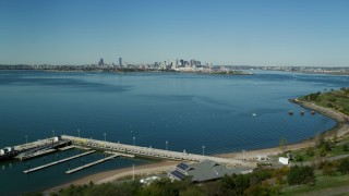 AX142_283 - 6K stock footage aerial video of Spectacle Island, Boston Harbor, Downtown Boston, Massachusetts