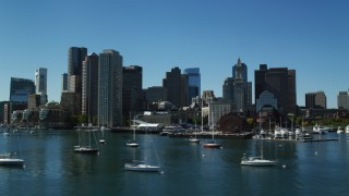 AX142_295 - 6K stock footage aerial video flying low by Rowes Wharf and the skyline, Downtown Boston, Massachusetts