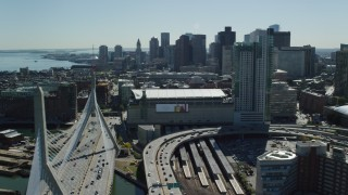 AX142_301 - 6K stock footage aerial video flying by the Zakim Bridge and TD Garden, Boston Massachusetts