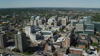 AX142_309 - 6K stock footage aerial video flying by the Longwood Medical Area, Boston, Massachusetts