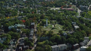 AX142_310 - 6K stock footage aerial video flying by Roxbury High Fort, Highland Park, Boston, Massachusetts
