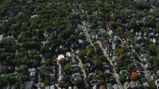 AX142_311 - 6K stock footage aerial video flying over suburban residential neighborhood, Jamaica Plain, Massachusetts