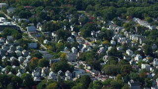 AX142_315 - 6K stock footage aerial video flying by small residential town, Roslindale, Massachusetts
