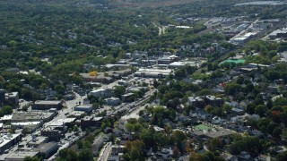 AX142_317 - 6K stock footage aerial video flying by large strip mall, neighborhoods, Hyde Park, Massachusetts