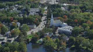 AX143_009 - 6K stock footage aerial video flying by South Congregational Church, small town, autumn, Braintree, Massachusetts