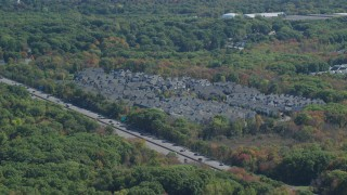 AX143_011 - 6K stock footage aerial video flying by Pilgrim Highway, condominium complex, autumn, Braintree, Massachusetts