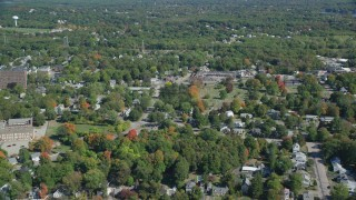 AX143_012 - 6K stock footage aerial video flying over small town neighborhoods, autumn, Weymouth, Massachusetts