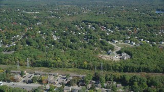 AX143_013 - 6K stock footage aerial video flying over small town neighborhoods, trees, autumn, Weymouth, Massachusetts