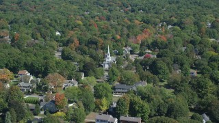 AX143_018 - 6K stock footage aerial video flying over small town, approach church, tilt down, autumn, Hingham, Massachusetts