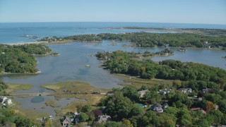 AX143_025 - 6K stock footage aerial video of small town, waterfront homes, small lake, autumn, Cohasset, Massachusetts