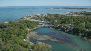 AX143_027 - 6K stock footage aerial video approaching upscale oceanfront homes, Cohasset, Massachusetts