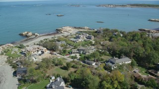 AX143_028 - 6K stock footage aerial video flying over upscale oceanfront homes, Cohasset, Massachusetts
