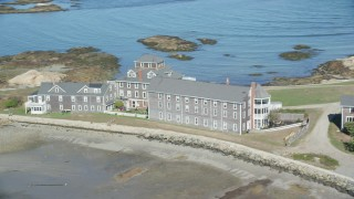 AX143_030 - 6K stock footage aerial video flying by isolated upscale oceanfront home, Scituate, Massachusetts