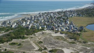 AX143_054 - 6K stock footage aerial video flying by oceanfront homes, waves crashing, Marshfield, Massachusetts