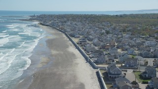 AX143_057 - 6K stock footage aerial video flying over beach,  oceanfront homes, small coastal town, Marshfield, Massachusetts