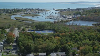 AX143_060 - 6K stock footage aerial video flying over small town, approaching marina, autumn, Marshfield, Massachusetts