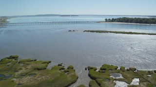AX143_066 - 6K stock footage aerial video flying over marshland, approach Powder Point Bridge, Duxbury, Massachusetts