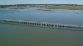 AX143_073 - 6K stock footage aerial video flying by the Powder Point Bridge, light traffic, Duxbury, Massachusetts