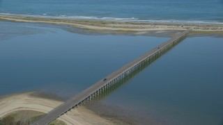 AX143_078 - 6K stock footage aerial video flying by Powder Point Bridge, light traffic, Duxbury, Massachusetts