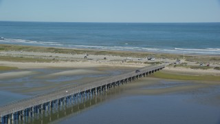 AX143_079 - 6K stock footage aerial video flying by Powder Point Bridge toward beach, Duxbury, Massachusetts