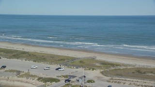AX143_080 - 6K stock footage aerial video flying by a beach, Atlantic Ocean, Duxbury, Massachusetts