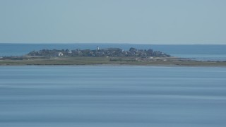 AX143_083 - 6K stock footage aerial video flying by Plymouth Light, coastal community, Duxbury, Massachusetts