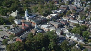 AX143_096 - 6K stock footage aerial video orbiting churches and shops in the small town, Plymouth, Massachusetts