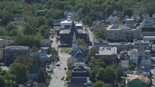 AX143_098 - 6K stock footage aerial video flying by small town, church, historic building, Plymouth, Massachusetts