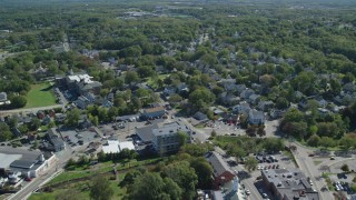 AX143_100 - 6K stock footage aerial video flying over small town stores and homes, Plymouth, Massachusetts
