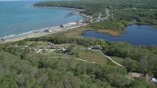 AX143_110 - 6K stock footage aerial video orbiting Plimoth Plantation, coastal community, Plymouth, Massachusetts