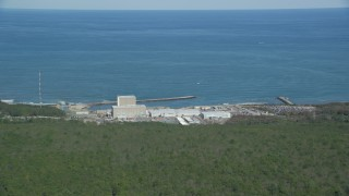 AX143_115 - 6K stock footage aerial video flying by Pilgrim Nuclear Generating Station, Cape Cod Bay, Plymouth, Massachusetts