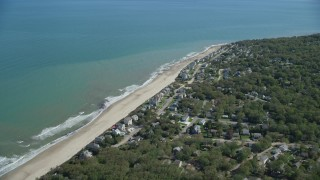 AX143_122 - 6K stock footage aerial video flying over small town, beachfront homes, Cape Cod Bay, Plymouth, Massachusetts