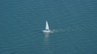 AX143_125 - 6K stock footage aerial video tracking a sailing boat on Cape Cod Bay, Massachusetts