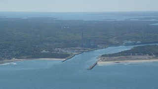 AX143_127 - 6K stock footage aerial video flying by power plant, Cape Cod Canal, Sandwich, Cape Cod, Massachusetts