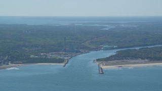 AX143_128 - 6K stock footage aerial video flying by power plant, Cape Cod Canal, Sandwich, Cape Cod, Massachusetts