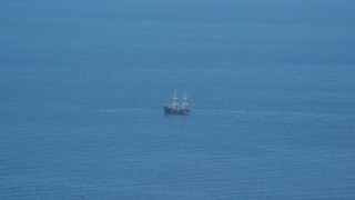 AX143_129 - 6K stock footage aerial video flying by historic sailing ship, Cape Cod Bay, Massachusetts