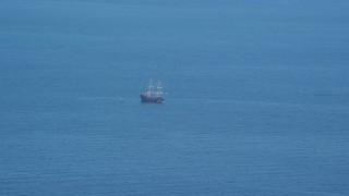 AX143_130 - 6K stock footage aerial video flying by historic sailing ship, Cape Cod Bay, Massachusetts